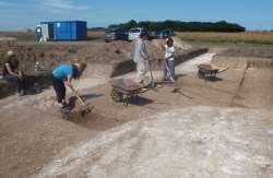 Excavating sections through the ring ditch
