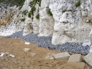 Inage of Shingle at the foot of the cliff