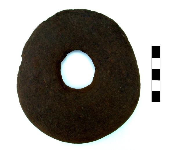 Kimmeridge shale perforated disc, later Saxon or Viking period.